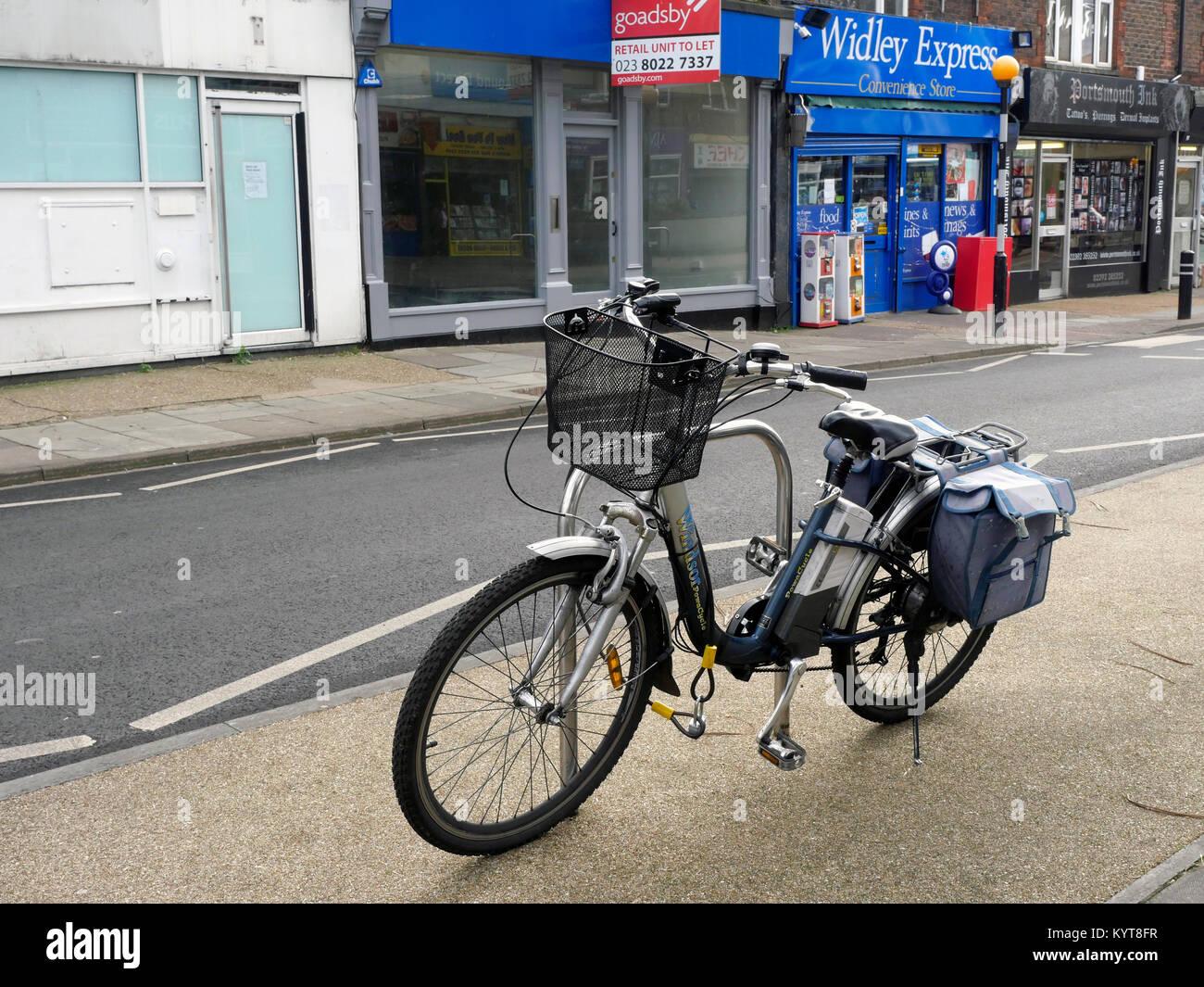 Electric assisted pedal bike on High Street, Cosham, Hampshire, England, UK Stock Photo
