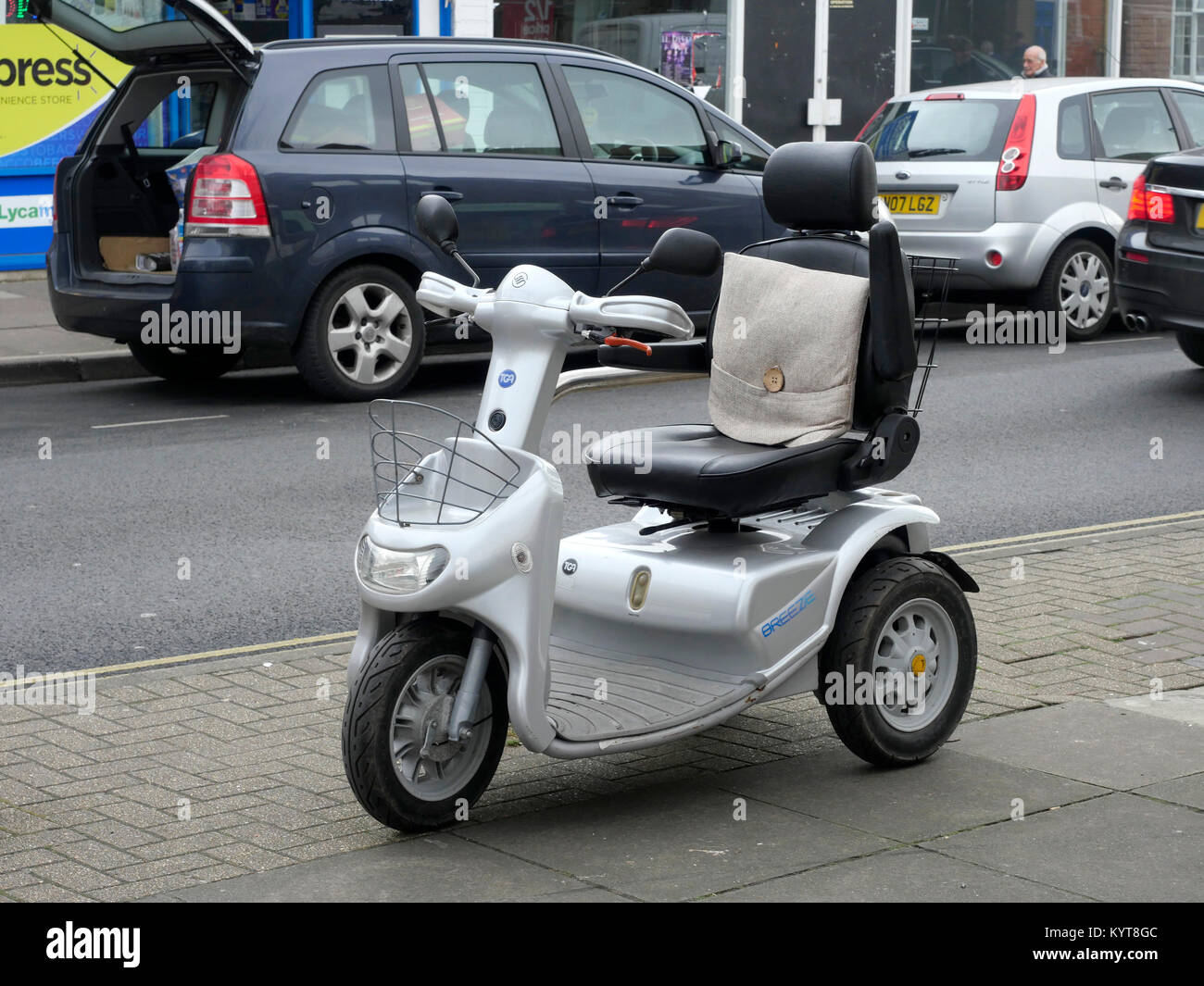 Electric mobility scooter in High Street, Cosham, Hampshire, England, UK Stock Photo