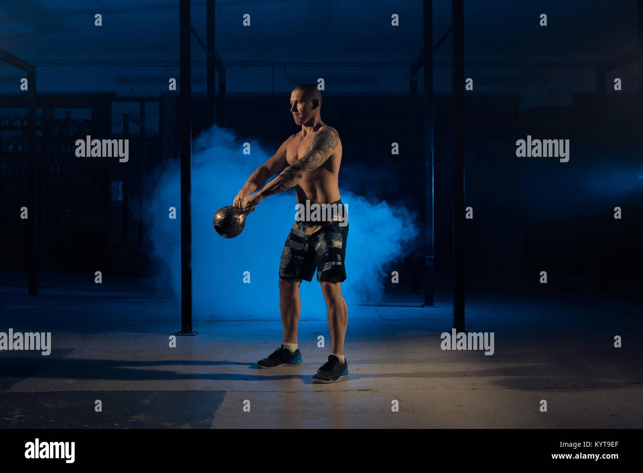 Athletics athlete man pulls weight. Weight-lifting - Stock Image