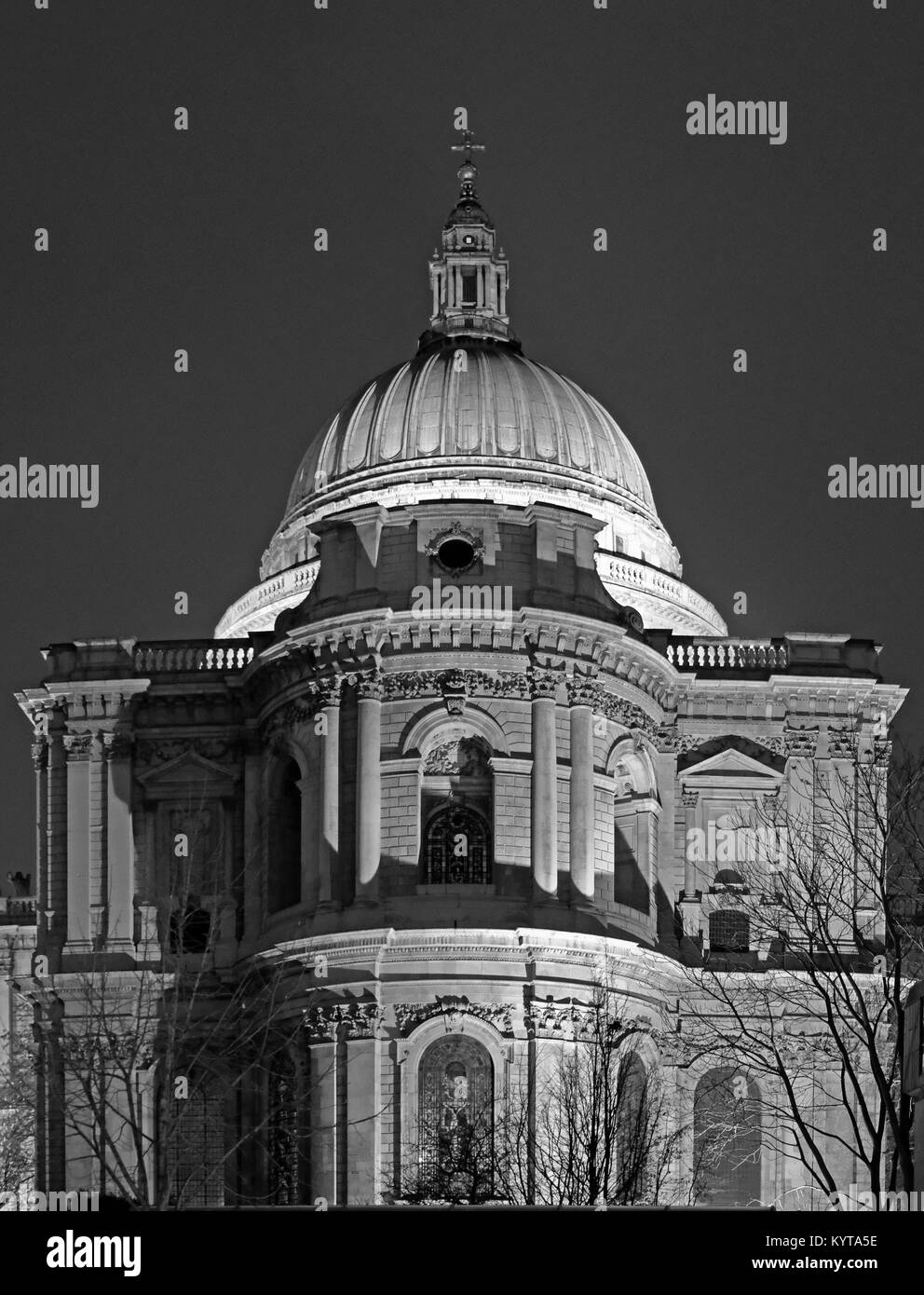 View of the dome of St Paul's Cathedral designed by Sir Christopher Wren. Dome is illuminated at night. Photo - Stock Image