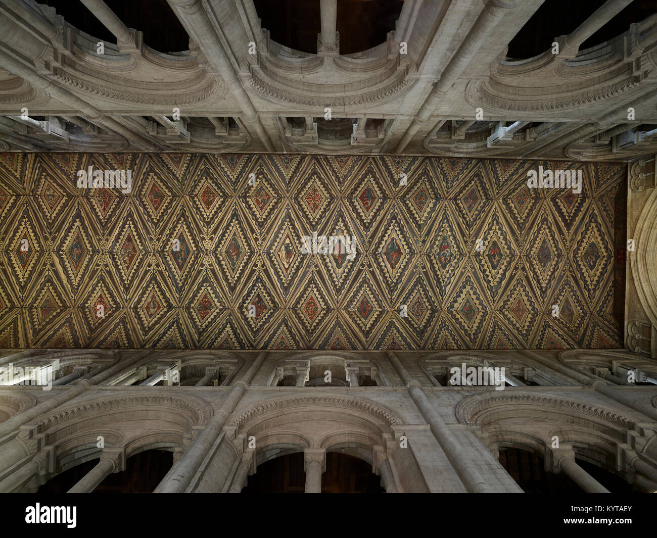 Peterborough Cathedral. View up  to the nave roof. The stonework is late Norman, twelfth century. The polychrome - Stock Image