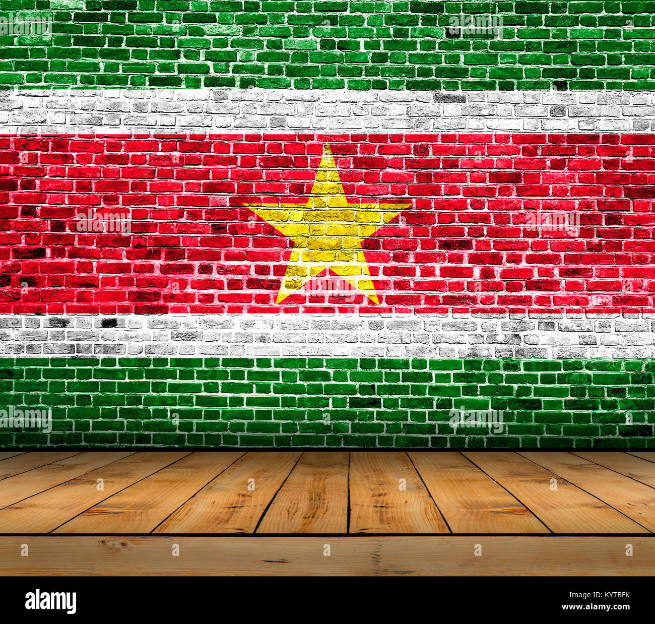 Suriname flag painted on brick wall with wooden floor - Stock Image