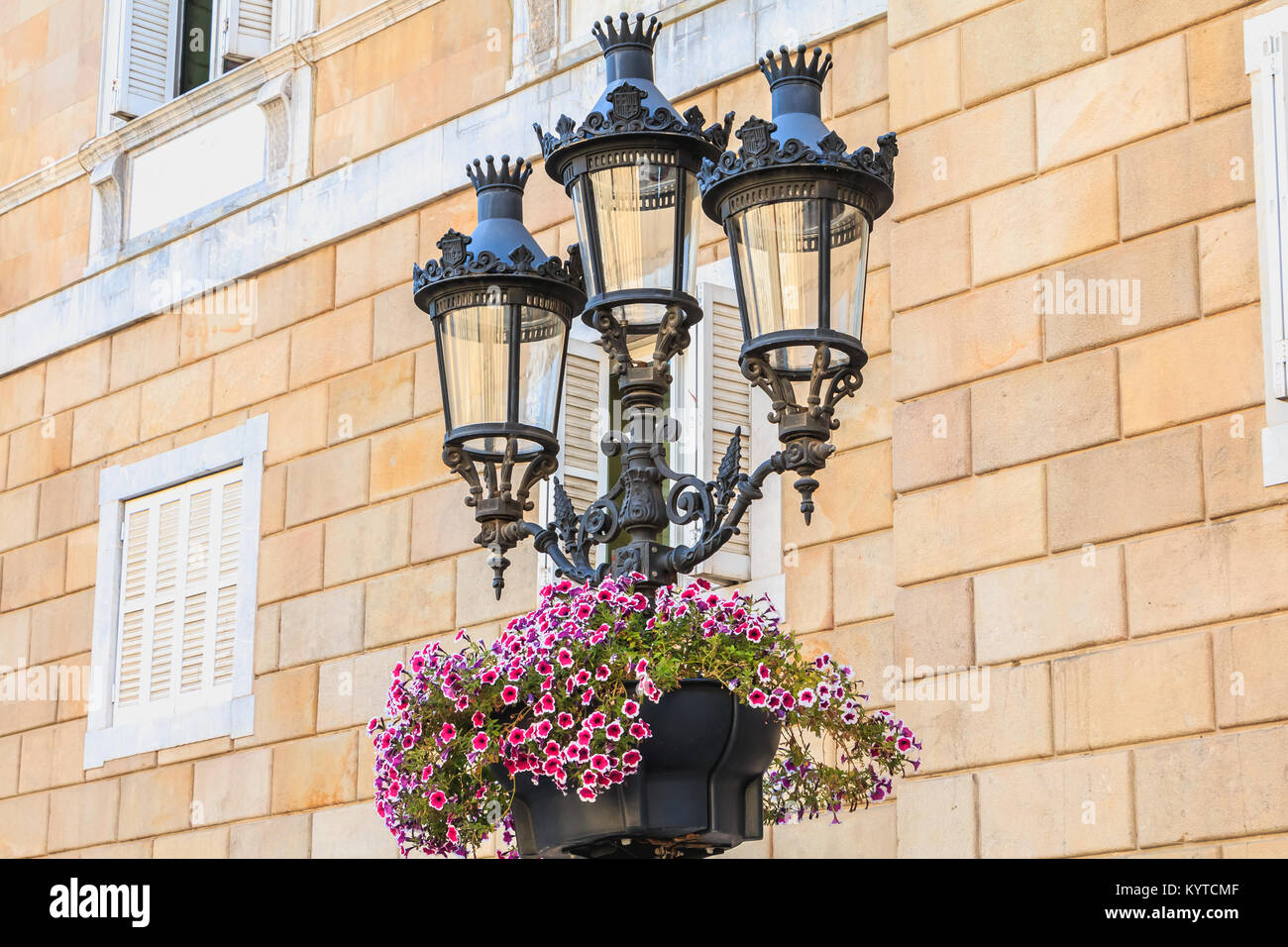 typical street lighting in the center of barcelona, spain with its spanish escutcheons - Stock Image