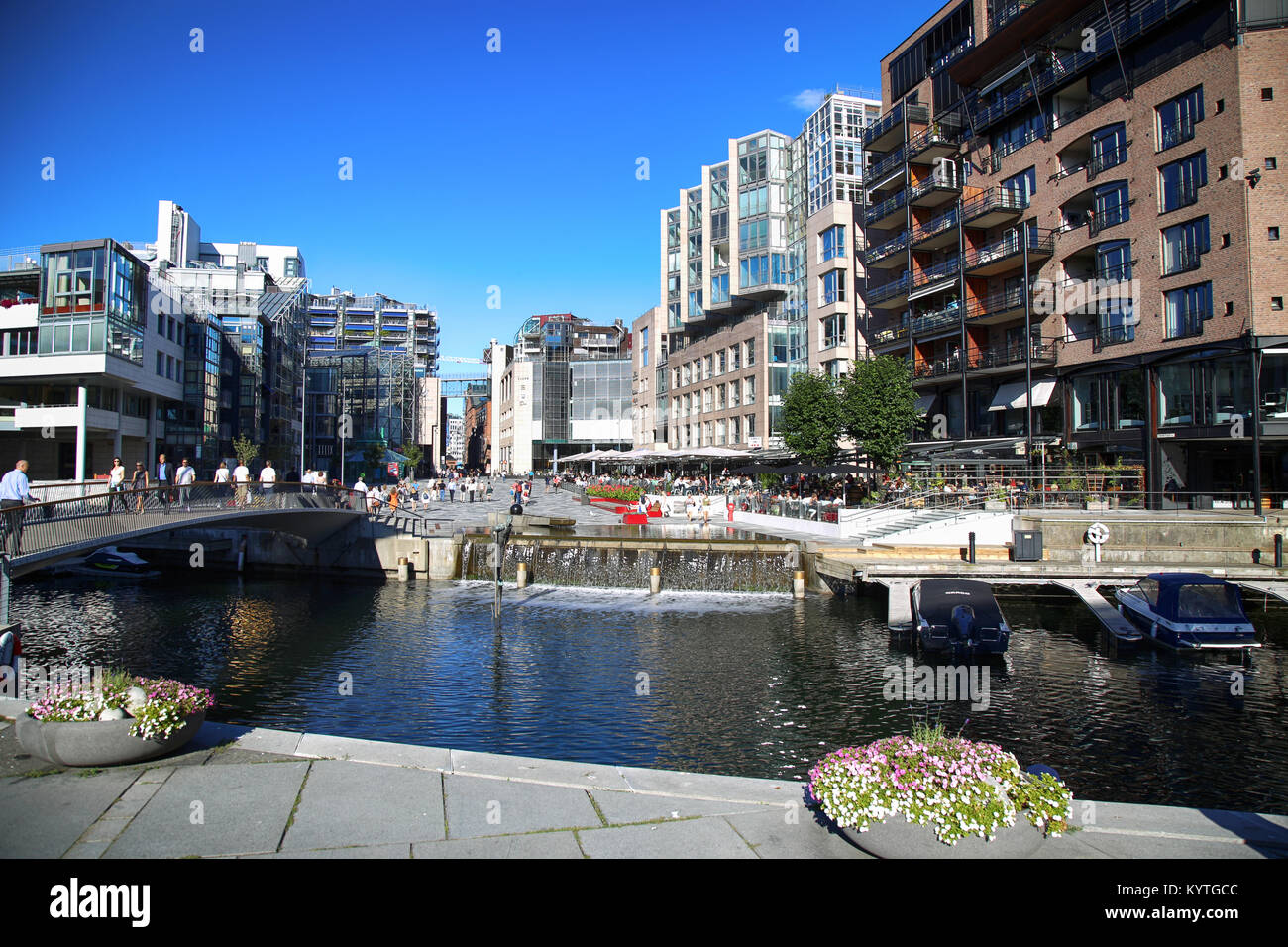 OSLO, NORWAY – AUGUST 17, 2016: People walking on wonderful modern residential district Aker Brygge with lux apartments, Stock Photo