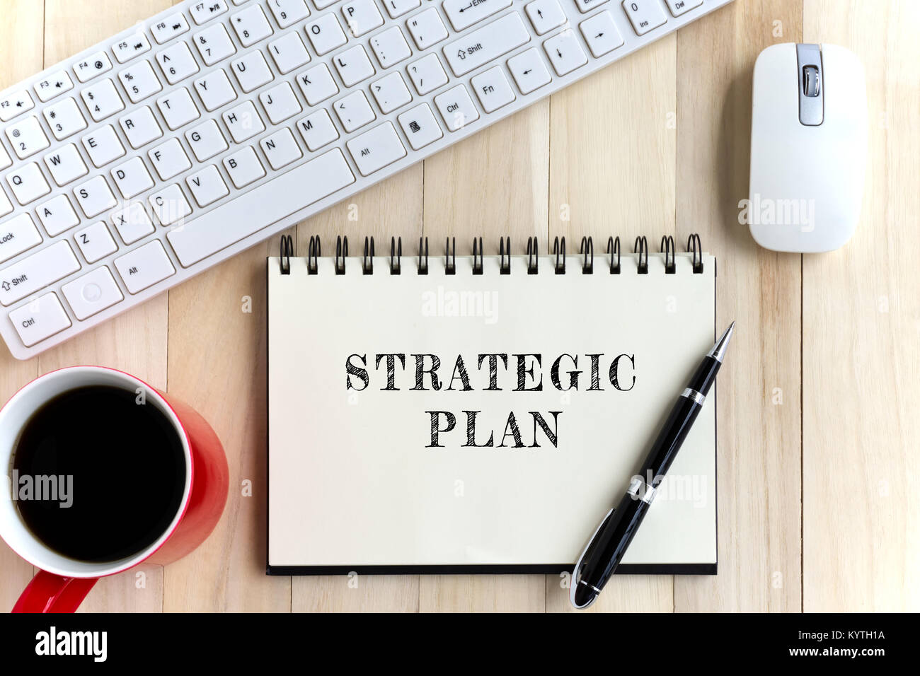 Top view of office desk and notepad with word - Strategic plan. Business concept. - Stock Image