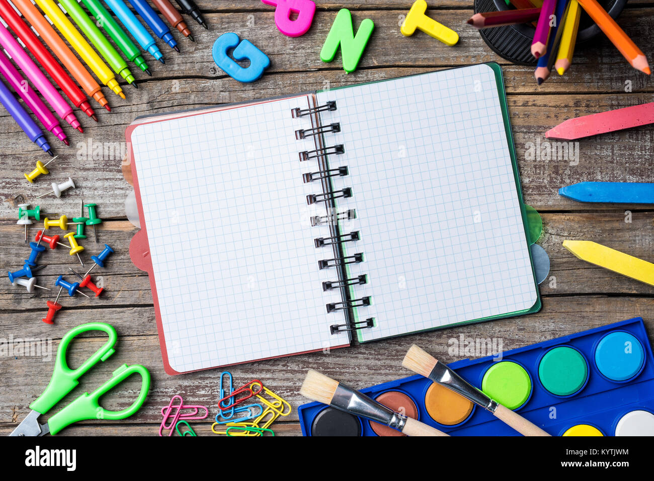 School supplies or accessories on an old wooden table Stock Photo