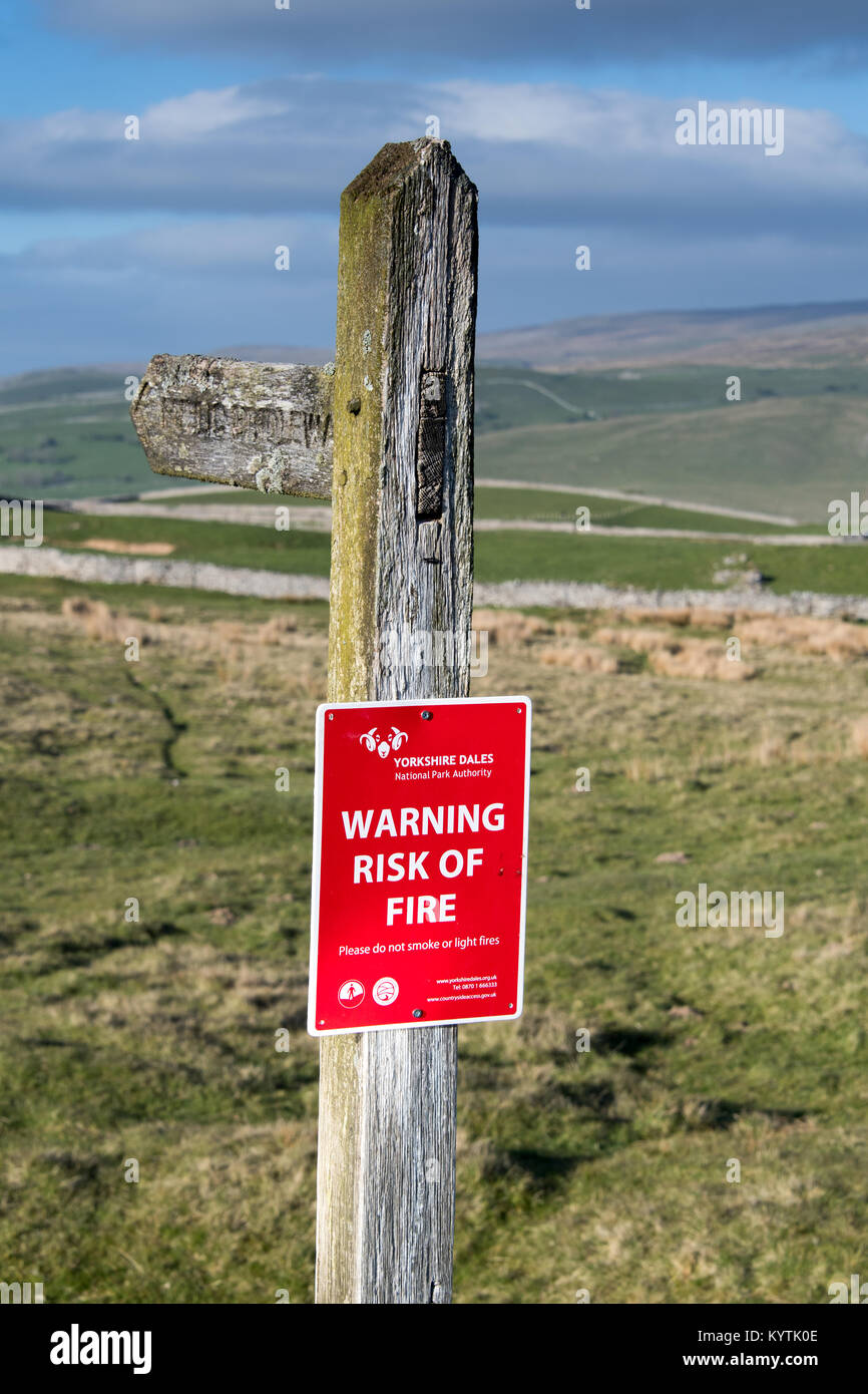 Signs on moorland within the Yorkshire Dales warning of the risk of fire in dry weather. - Stock Image