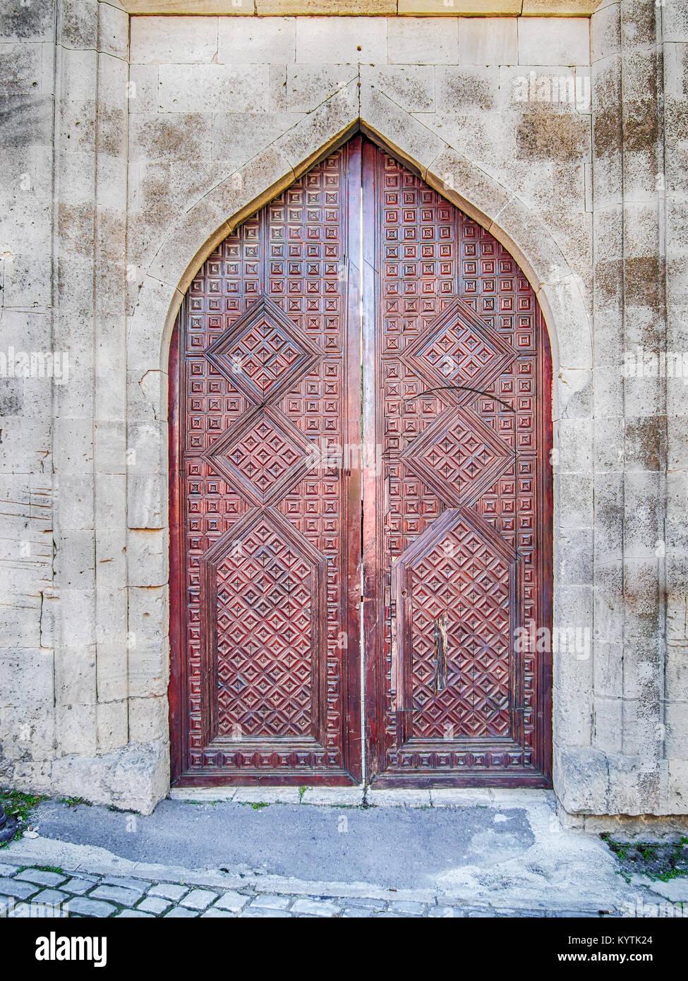 Asian style ancient wooden door in Baku old town - Stock Image