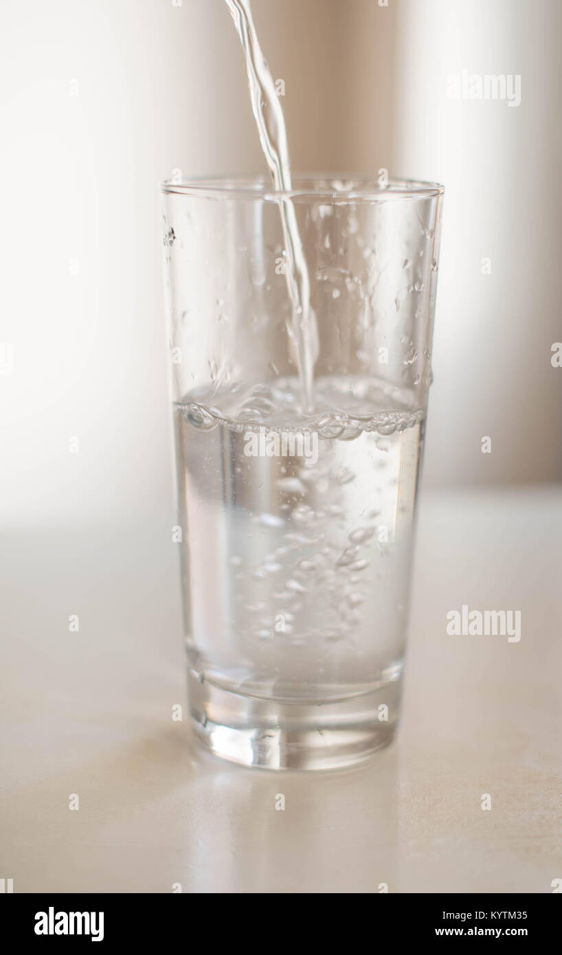 A glass of refreshingly cold water - Stock Image