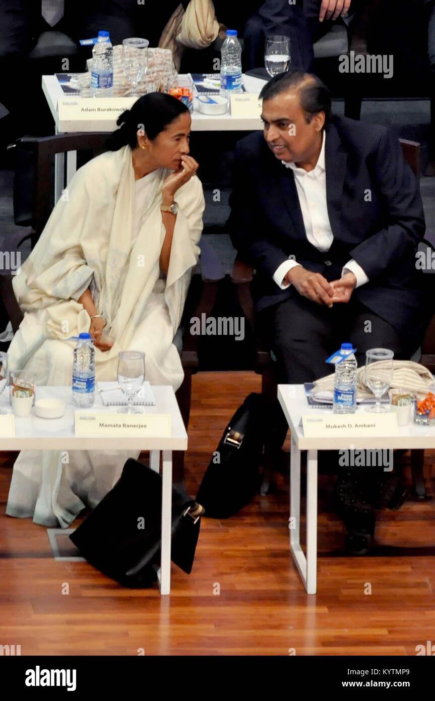 Kolkata, India. 16th Jan, 2018. Chief Minister Mamata Banerjee speaks to Industrialist Mukesh Ambani during the - Stock Image