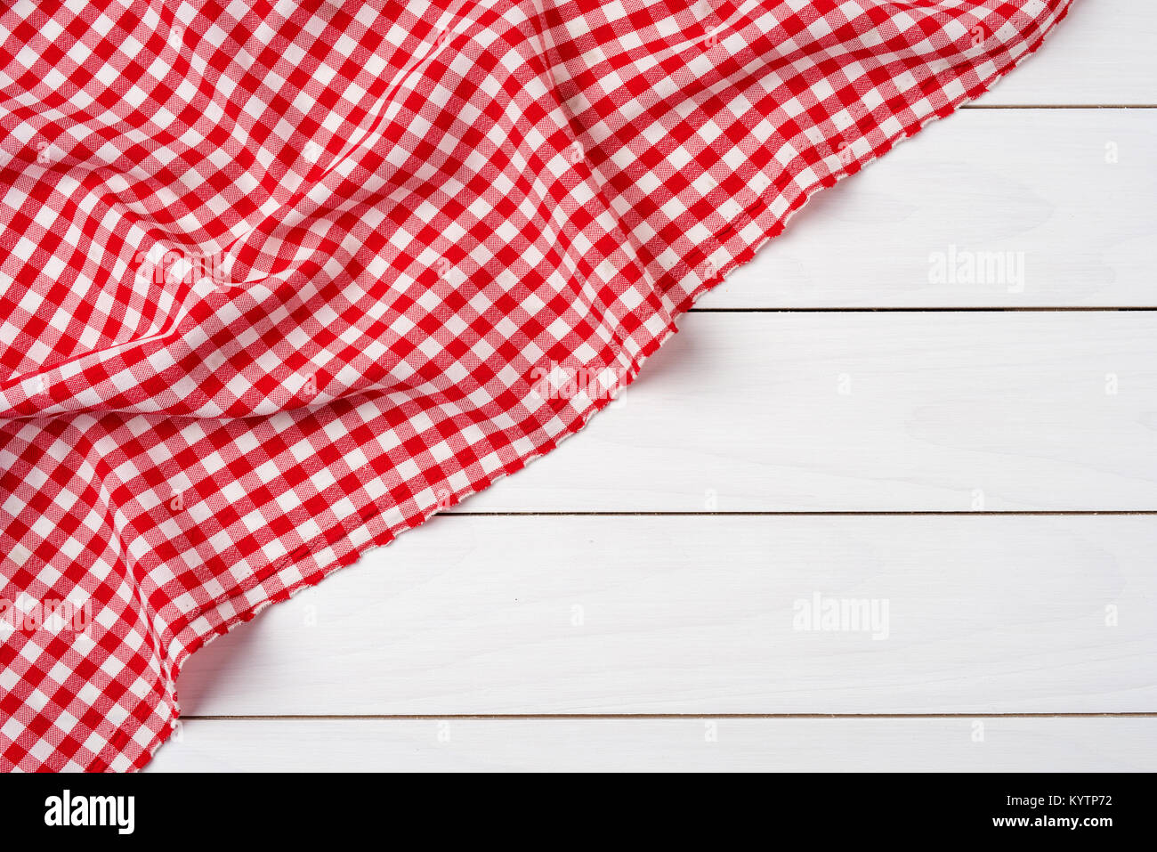 Red checkered tablecloth over white wooden table Stock Photo ...