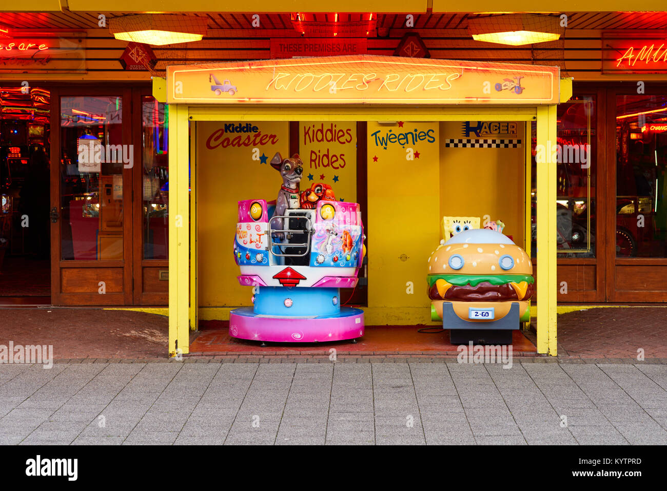 Kiddies rides outside an amusment arcade in Clacton, Essex - Stock Image
