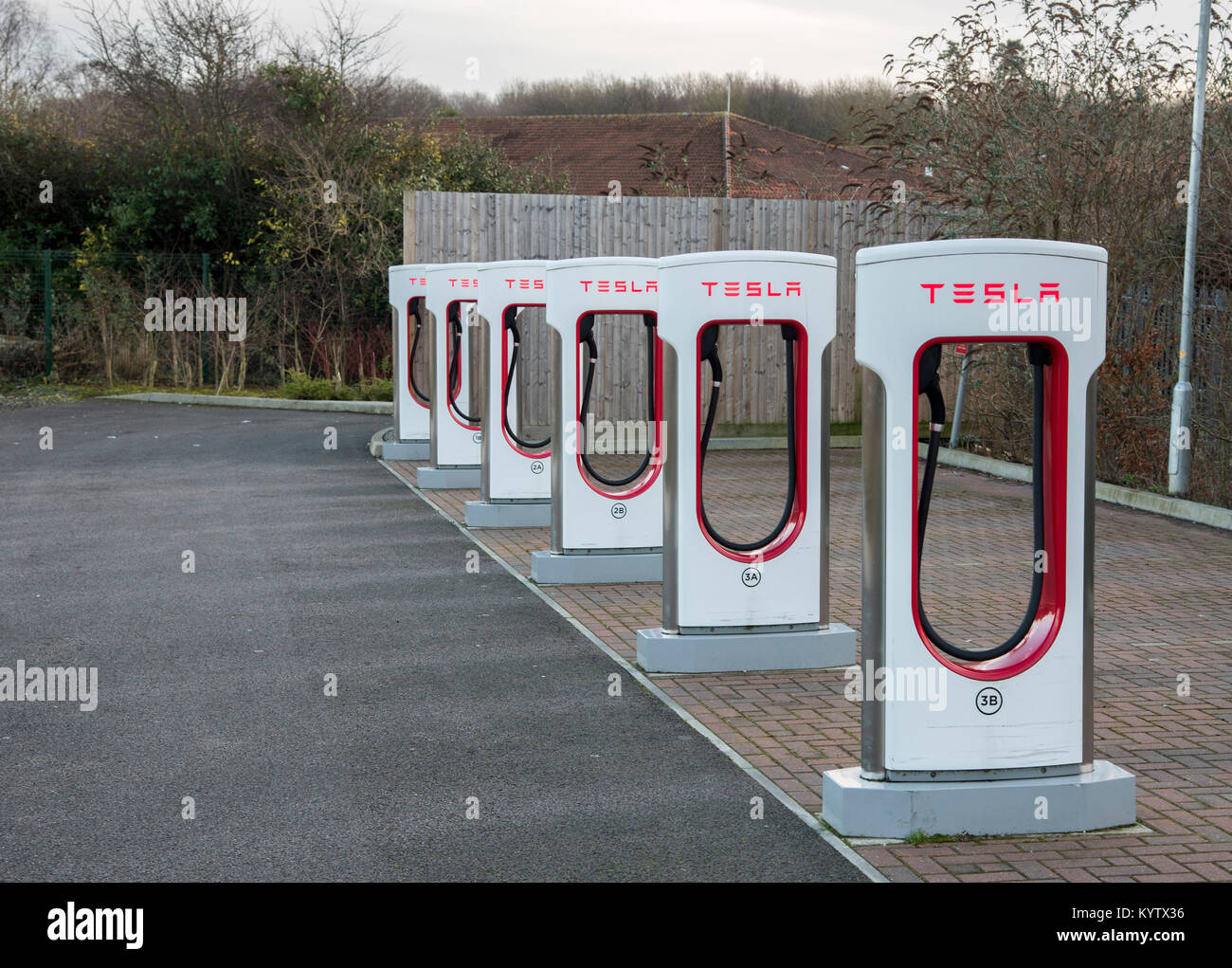 Picture shows a Tesla Supercharger point for electric vehicles in a car park in Maidstone Kent - Stock Image