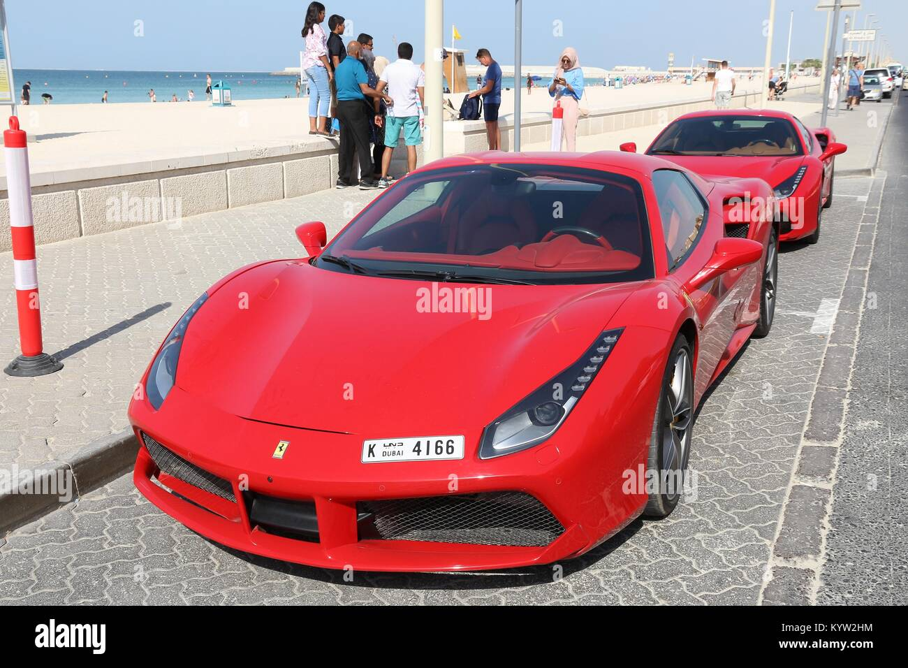 DUBAI, UAE   NOVEMBER 23, 2017: People Walk By Ferrari 488 GTB In Dubai, United  Arab Emirates. Dubai City Has A Car Ownership Rate Of 541 Cars Per 1,0