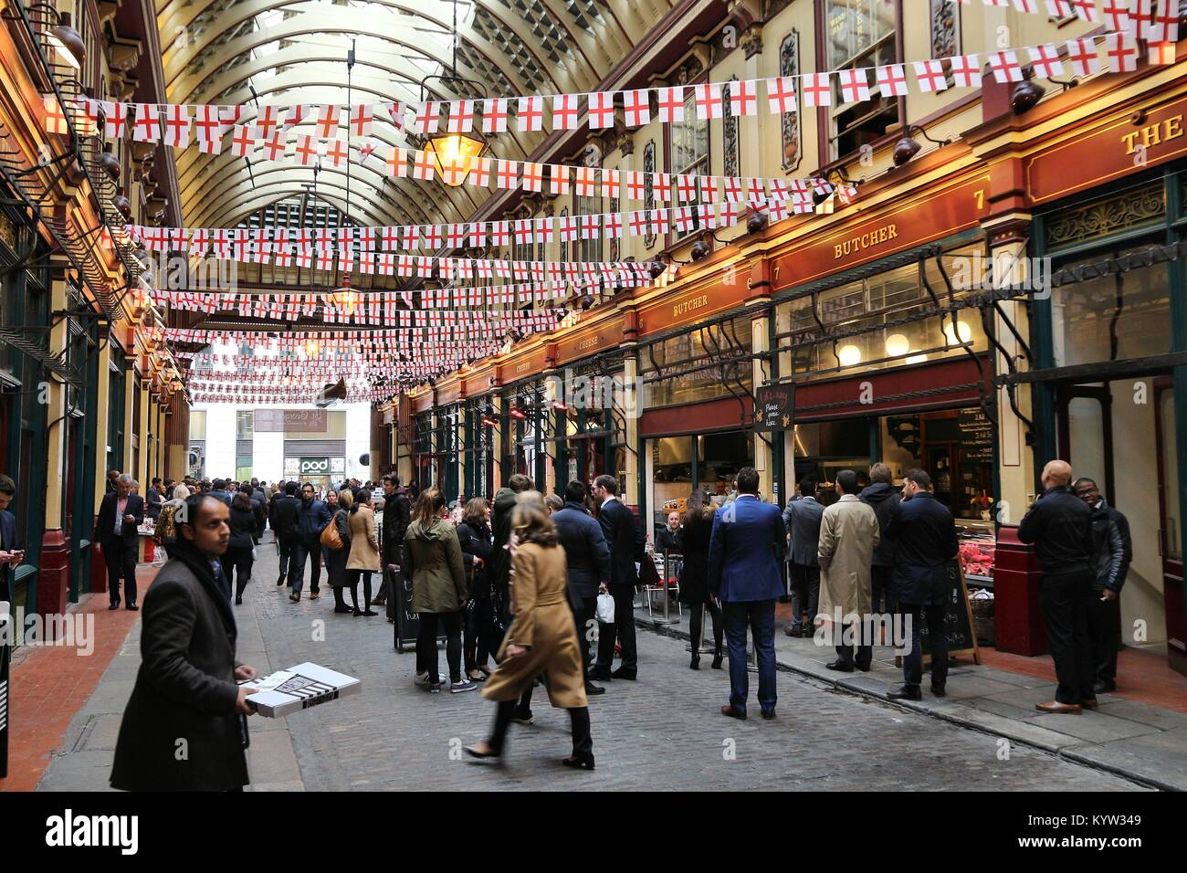 LONDON, UK - APRIL 22, 2016: People celebrate Saint George's Day in Leadenhall Market, London. Saint George - Stock Image