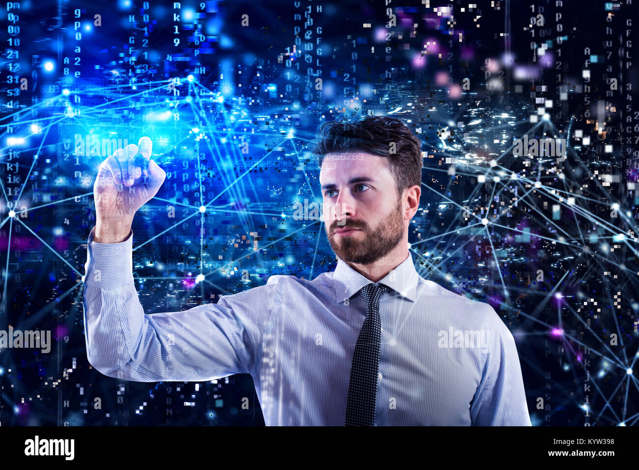 Programmer man works with a laptop on a network application - Stock Image
