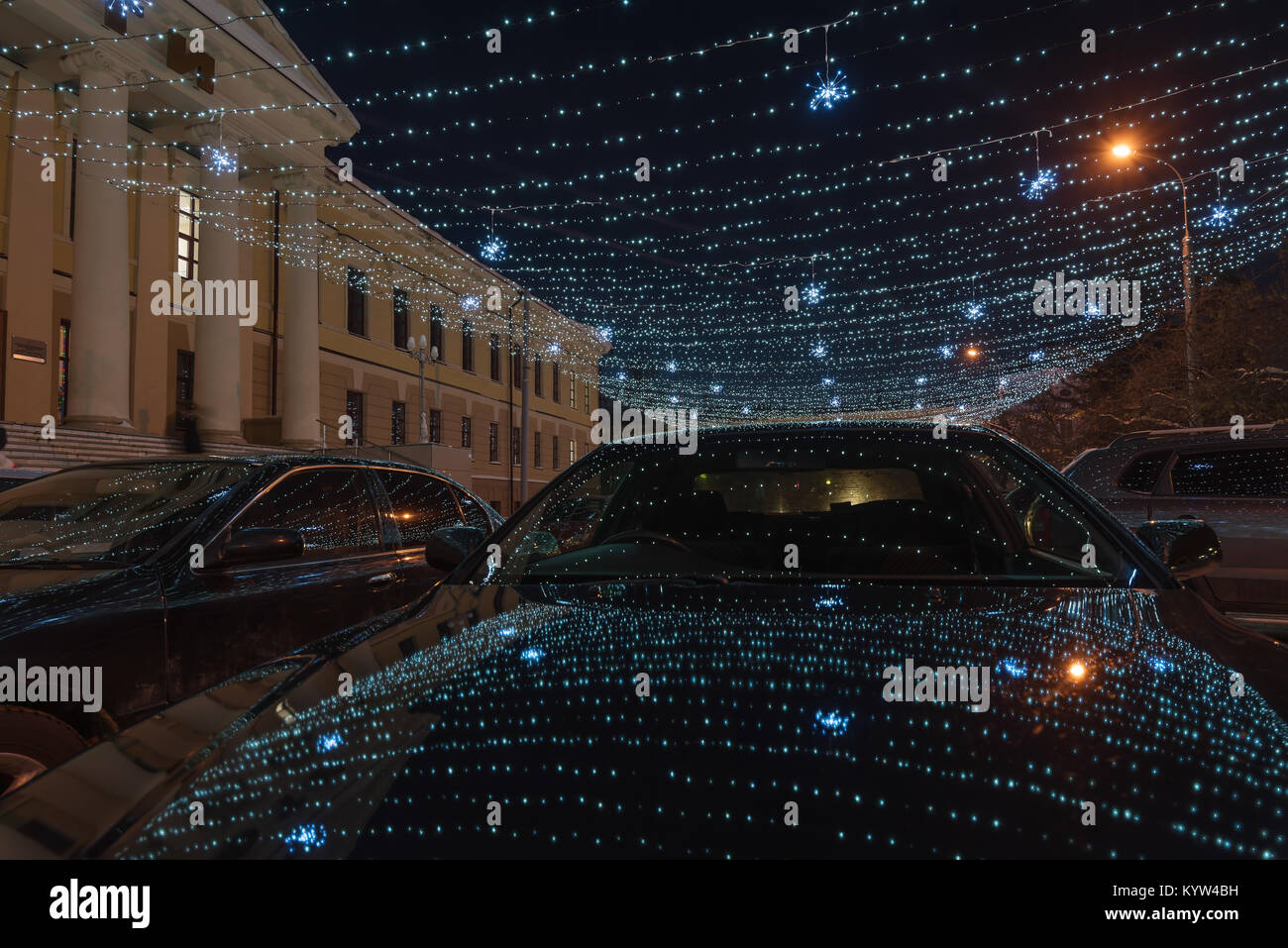Part of a winter street lit by garlands Stock Photo