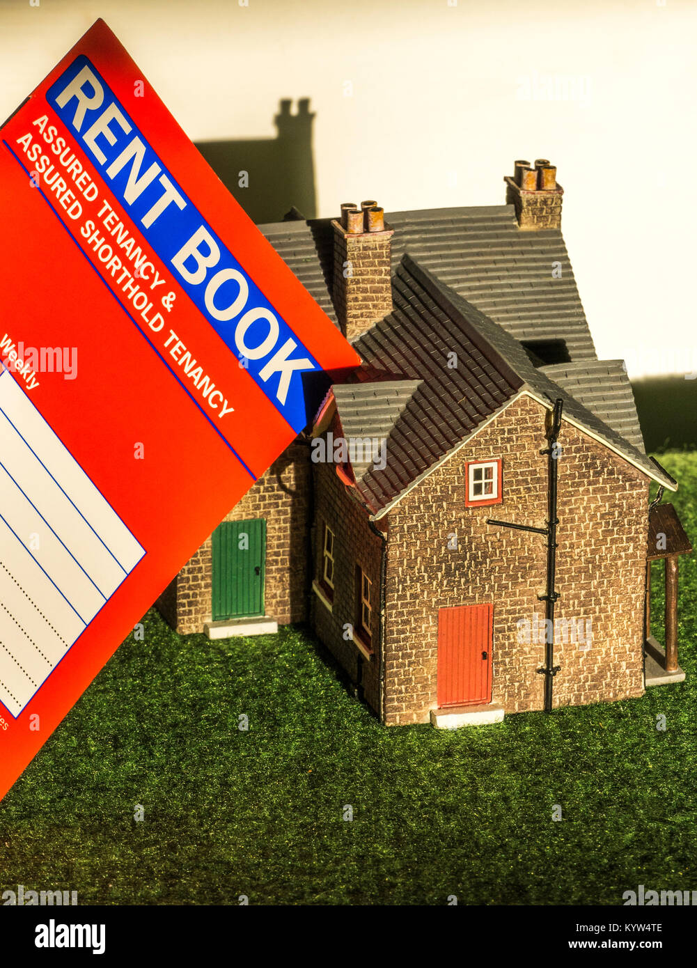A model house and rent book, used for a private sector, assured shorthold tenancy, in England and Wales. General - Stock Image