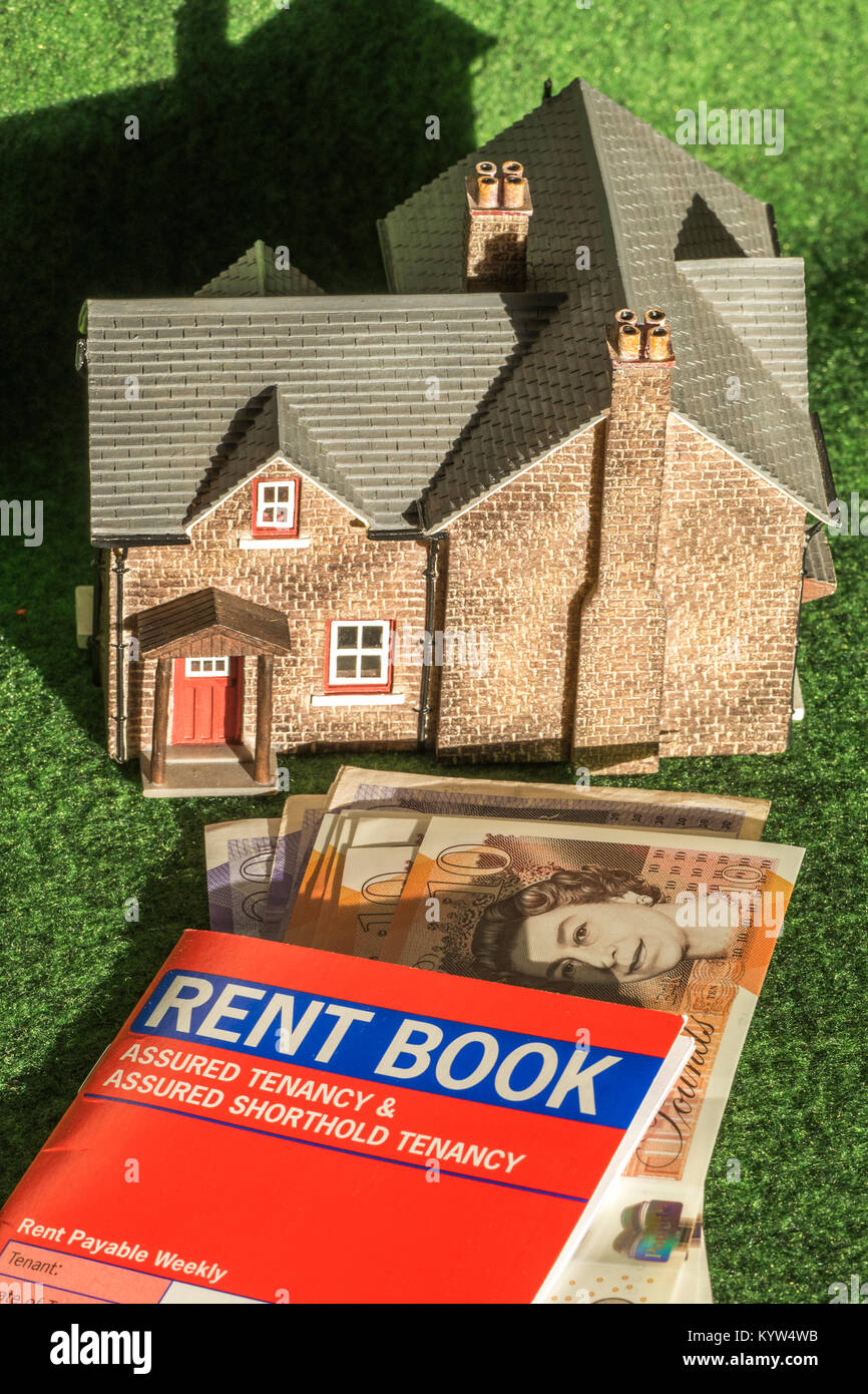 Model house, rent book (for assured shorthold tenancy, in England and Wales) and pounds sterling notes. General - Stock Image