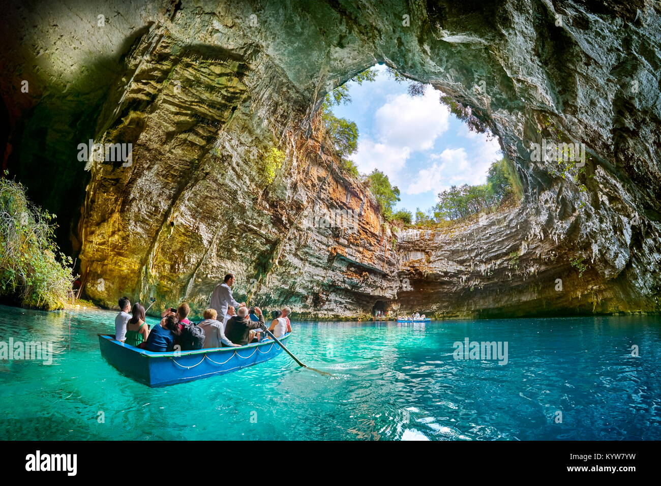 Tourist boat on the lake in Melissani Cave, Kefalonia Island, Greece - Stock Image
