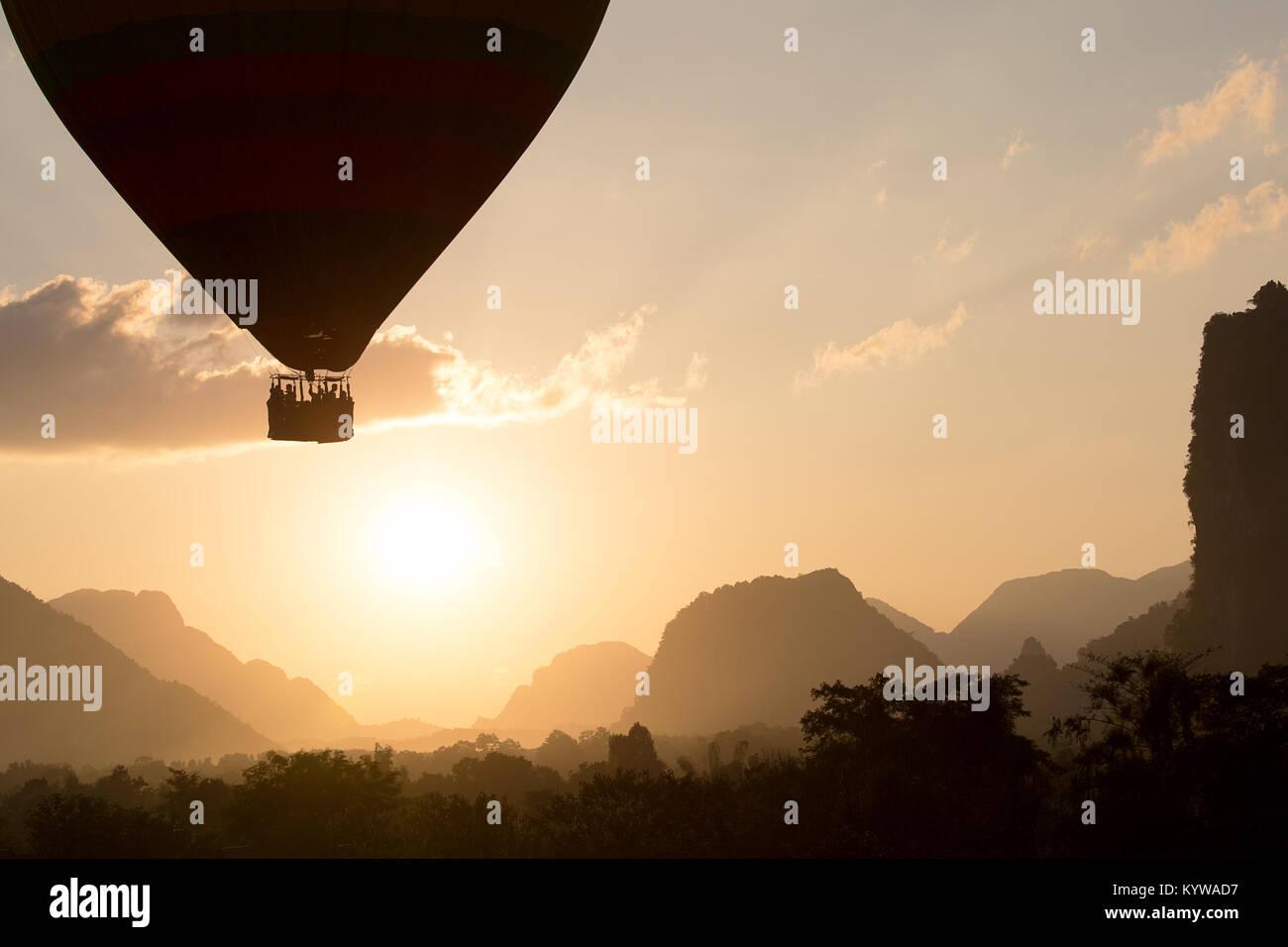 Balloon Ride for sunset between wonderfull karst mountains in Vang Vieng, Laos - Stock Image