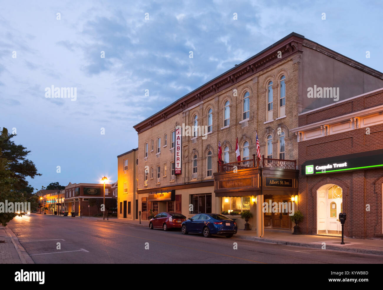 The Albert Street Inn Ltd or Albert Place Hotel seen here at dusk located in Stratford, Ontario, Canada. - Stock Image