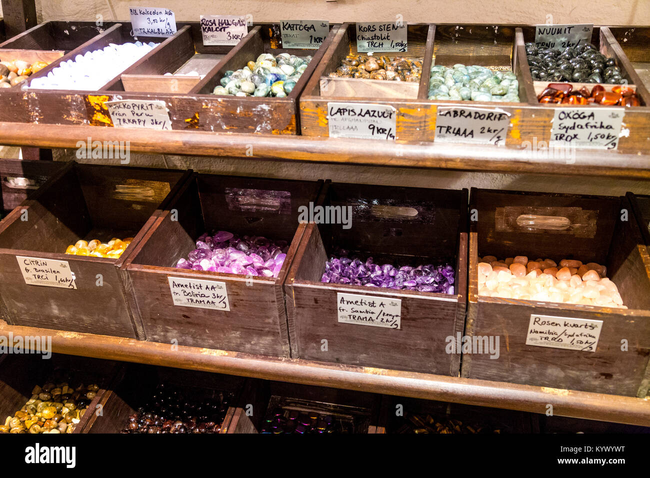 Selection of polished precious stones in wooden boxes (Kristallrummet, Stockholm, Sweden) - Stock Image