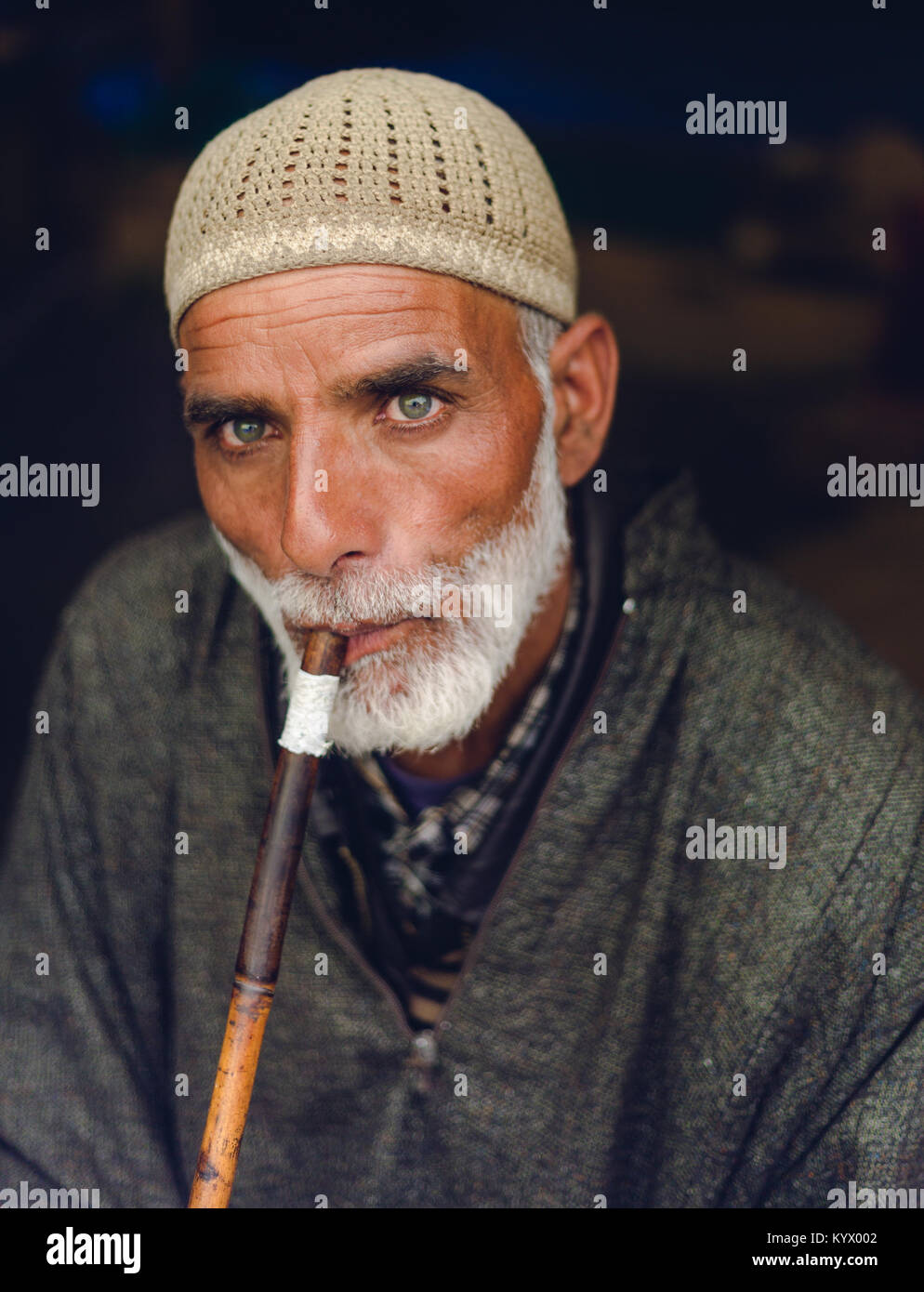 Sonamarg, Jammu & Kashmir - August 11 2017: An Old traditional muslim Kashmiri man smokes Sheesha/Hookah at - Stock Image