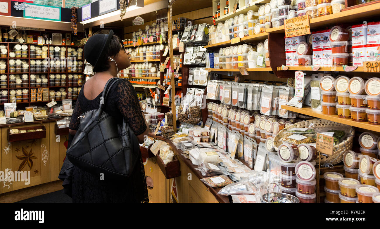 Customer browsing spices on sale at the Spice Mountain shop