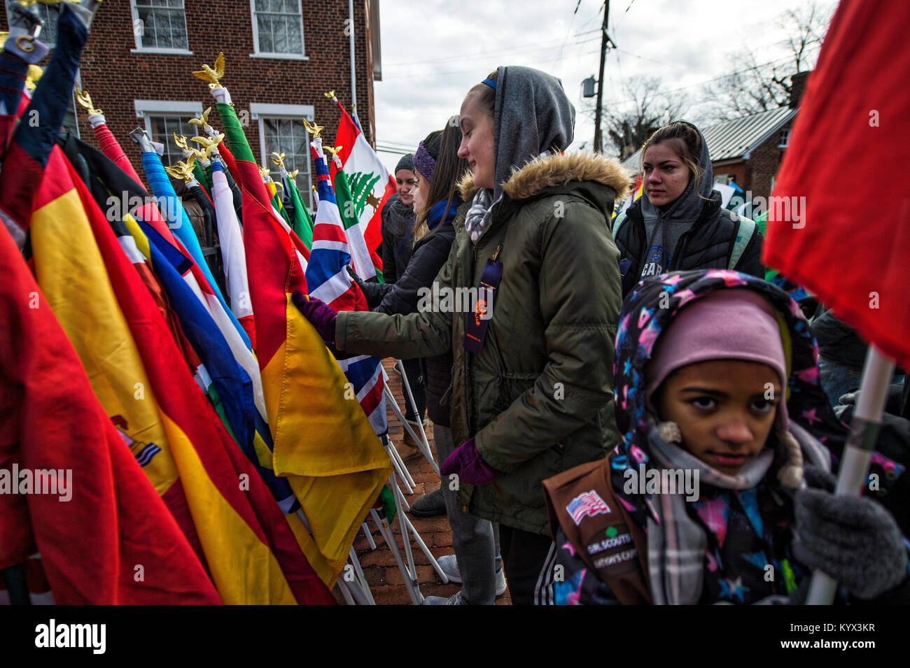 UNITED STATES - 01152018:  Kids grab flags for the march from Loudoun County Court House in downtown Leesburg to - Stock Image