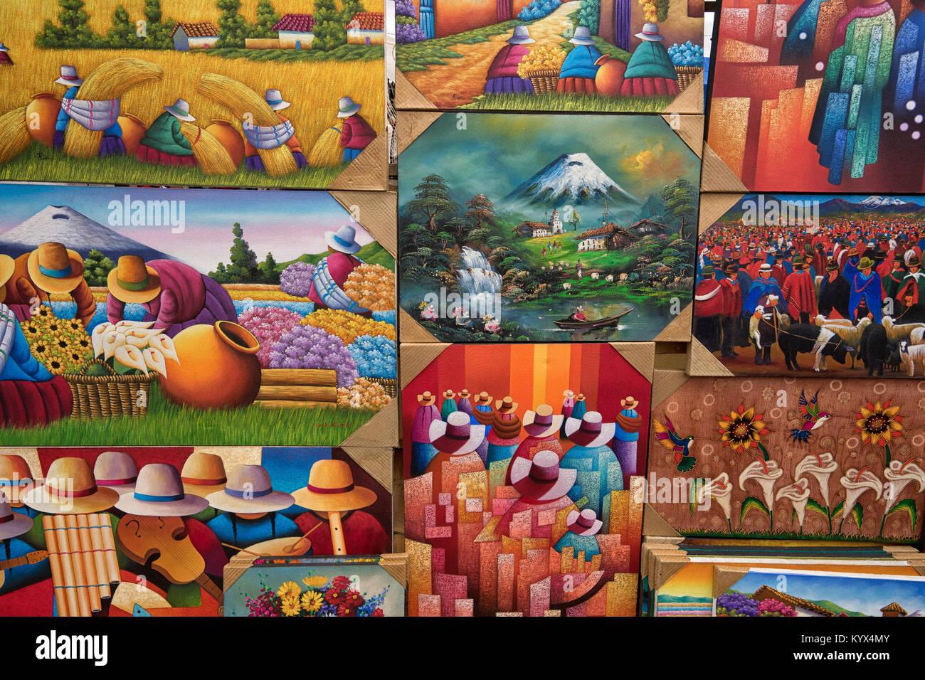 Otavalo, Ecuador - January 13, 2018: closeup of colourful indigenous paintings in the popular artisan market - Stock Image