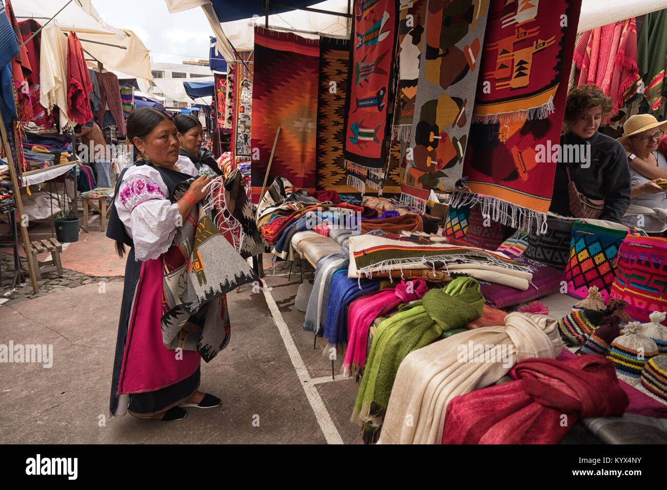 Otavalo, Ecuador - January 13, 2018: the artisan market in Plaza de Ponchos is very popular with tourists - Stock Image