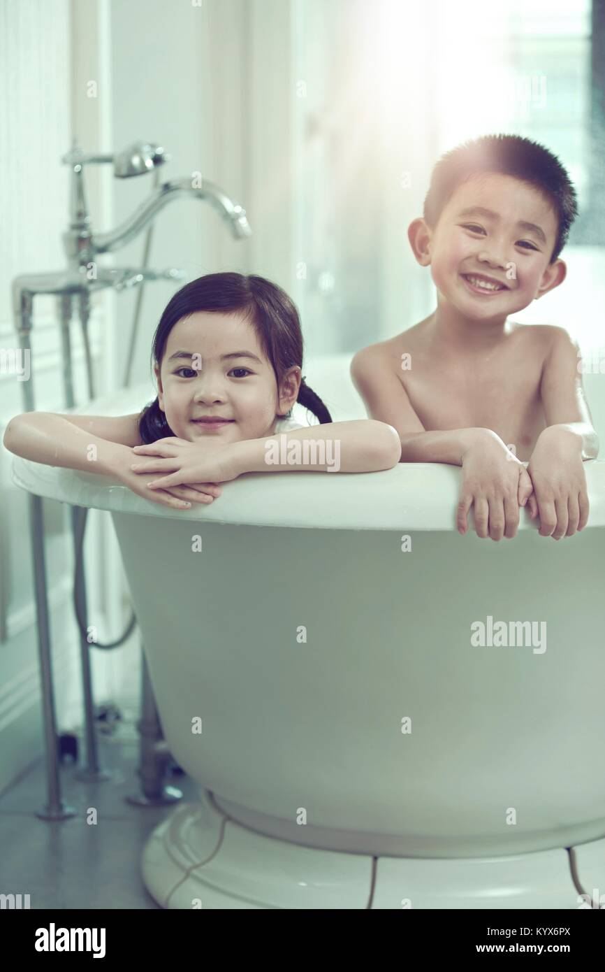 The lovely boy and girl are in the bathtub Stock Photo: 172065122 ...