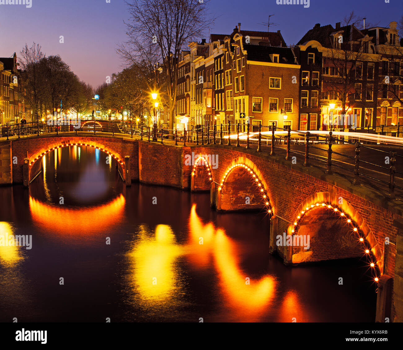 Five Bridges over the Prinsengracht Canal at dusk, Amsterdam, Holland, Netherlands. - Stock Image