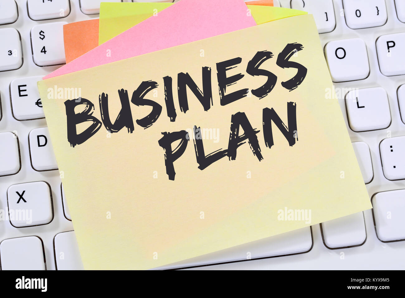 Business plan analysis strategy success concept company note paper computer keyboard - Stock Image