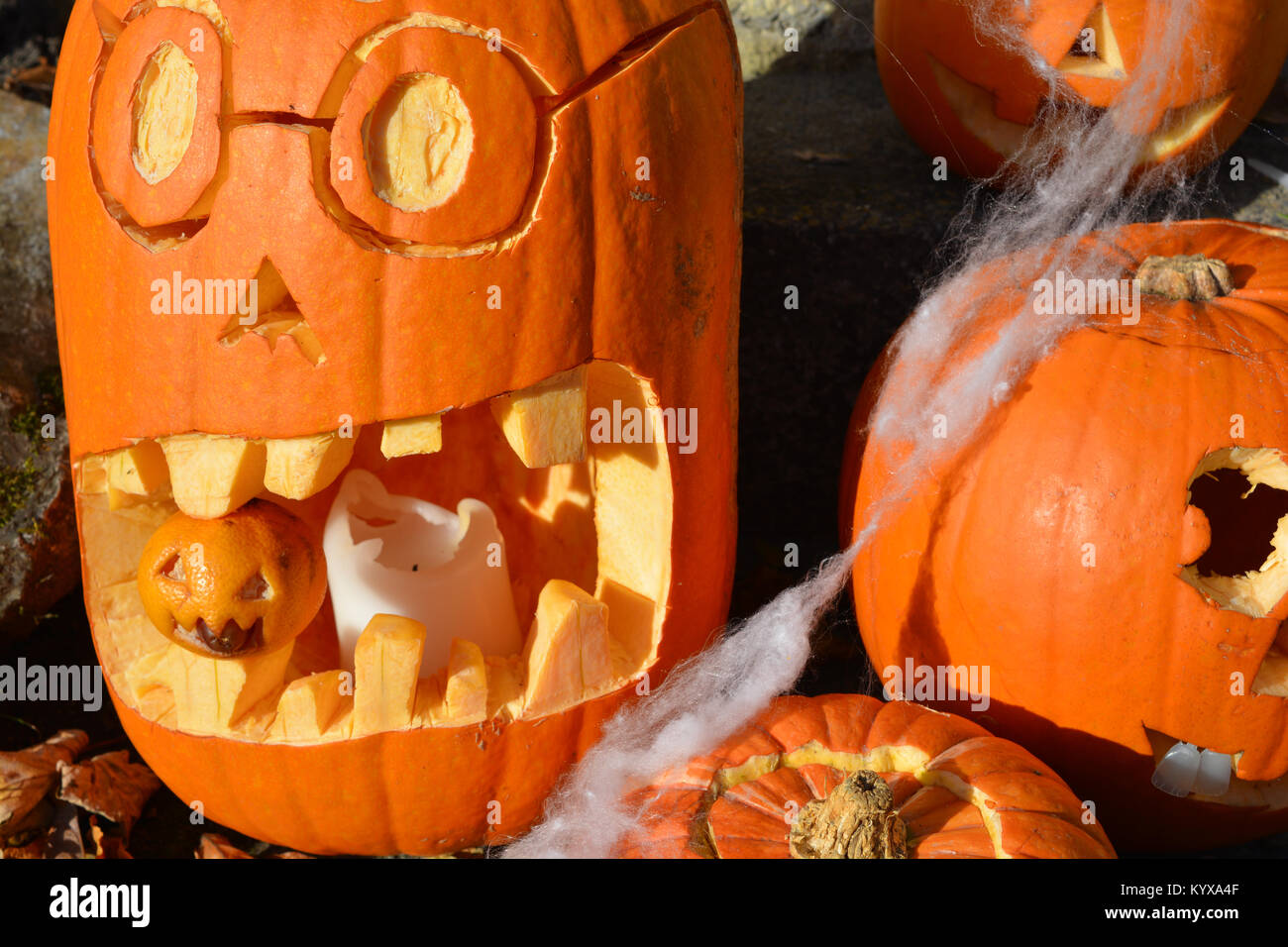 Carved halloween pumpkins and a carved tangerine on a doorstep - Stock Image & Spirit Halloween Stock Photos \u0026 Spirit Halloween Stock Images - Alamy