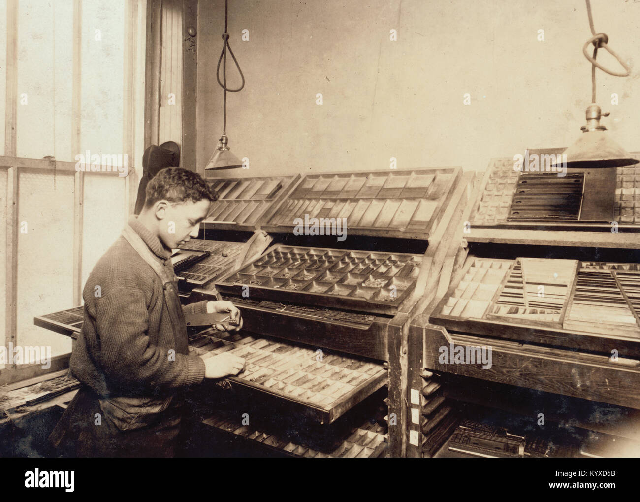 A young compositor earning $7.00 a week in a Sixth Av. (N.Y.) printing office. - Stock Image