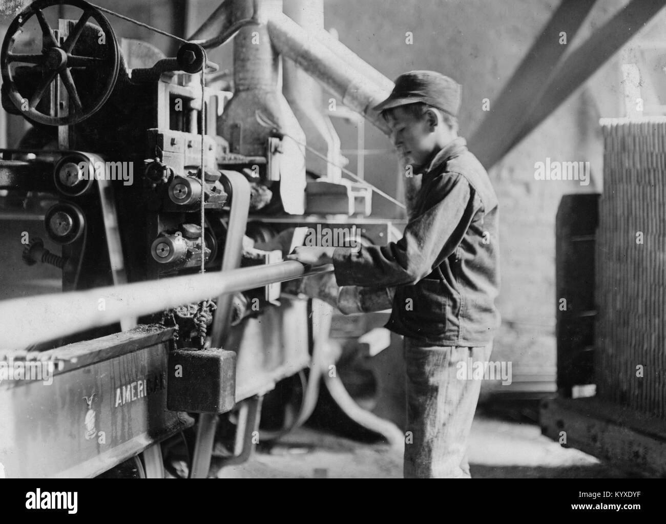 Indiana Mfg. Co., Boy taking boards away from 'double cut-off' machine. - Stock Image