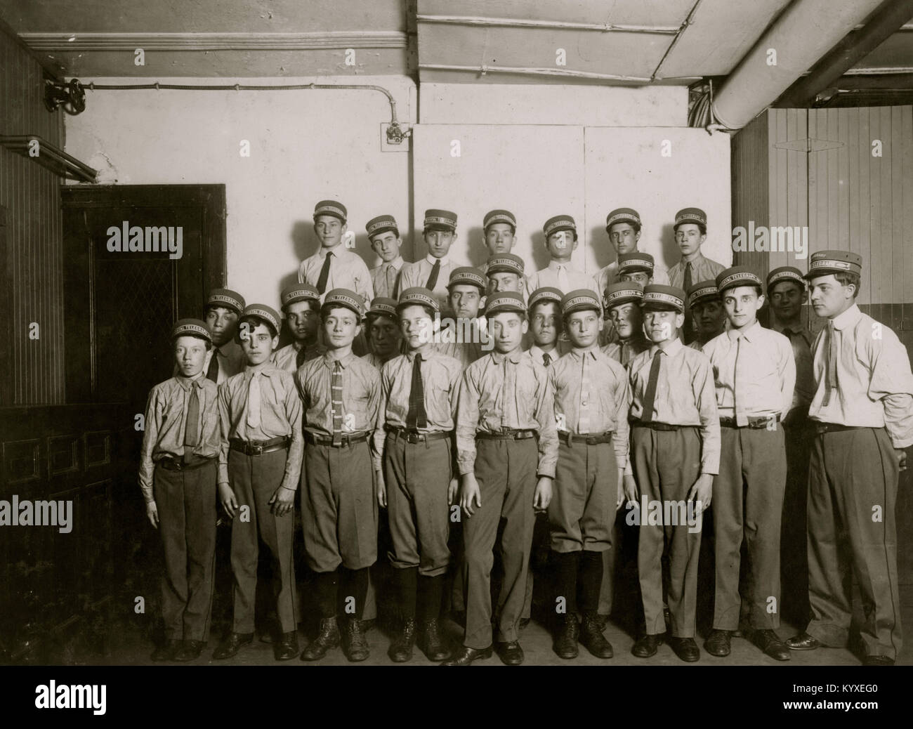 A typical group of messengers at Postal Telegraph Company's main office, 253 Broadway. - Stock Image