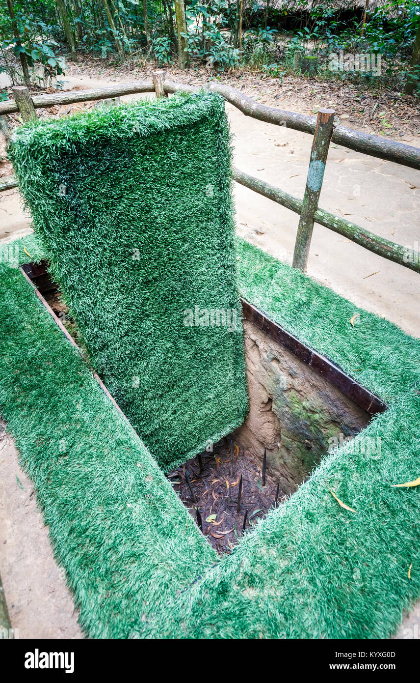 Deadly pit with concealed booby trapped door in the iconic Cu Chi Tunnel network hidden Viet Cong tunnels Saigon (Ho Chi Minh City) south Vietnam & Deadly pit with concealed booby trapped door in the iconic Cu Chi ...