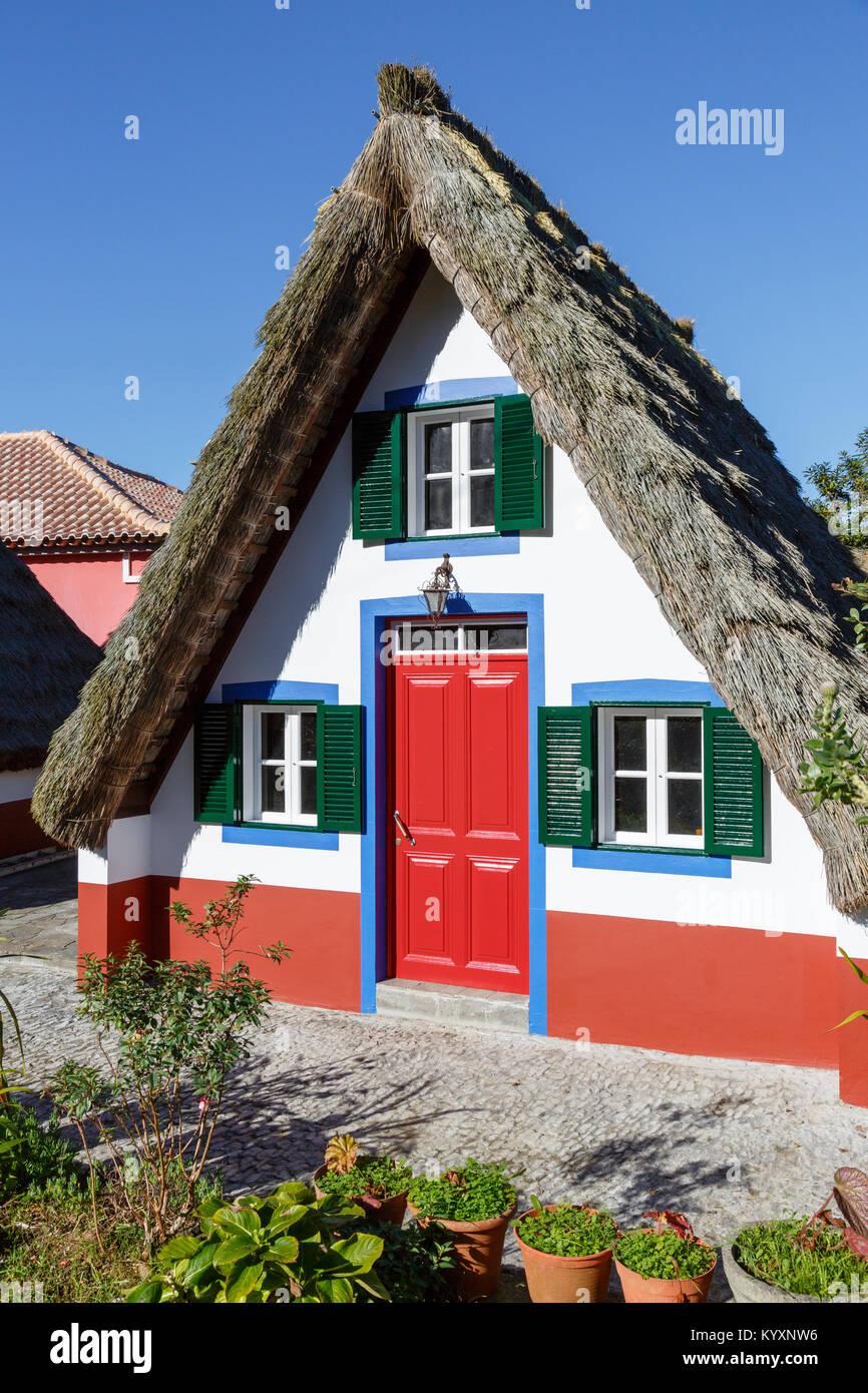 Traditional triangular houses (palheiros) at Santana, Madeira Stock Photo