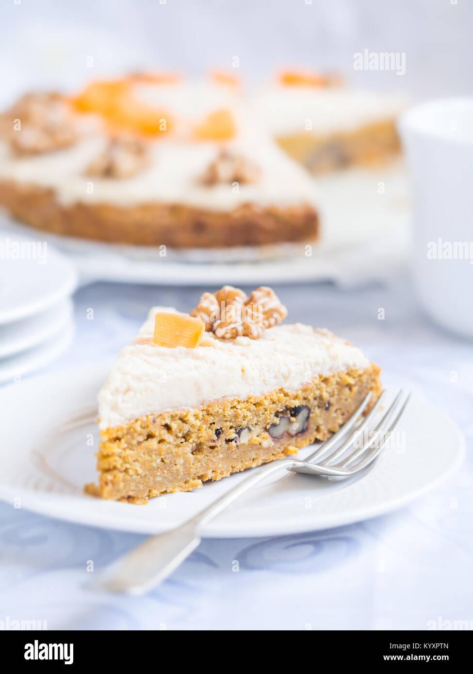 Slice of gluten-free carrot cake. - Stock Image