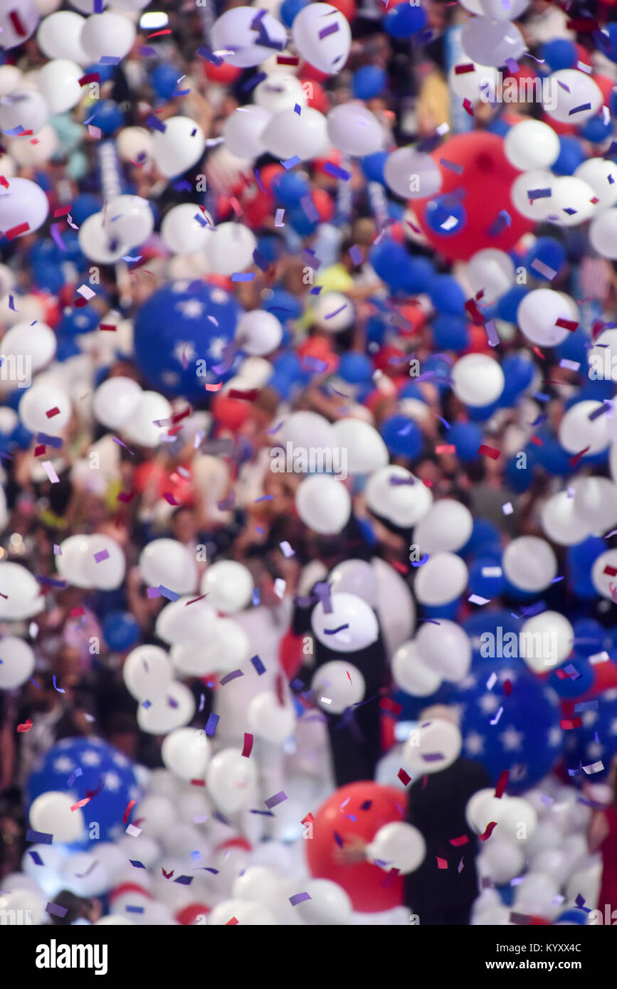 red white and blue balloons confetti falling on delegates / Hillary Clinton / Bill Clinton / Tim Kaine at the 2016 - Stock Image