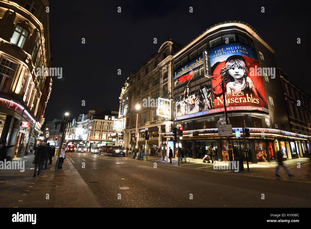 leicester square city crossroads on a January evening in 2018 showing theaters, traffic and people. - Stock Image