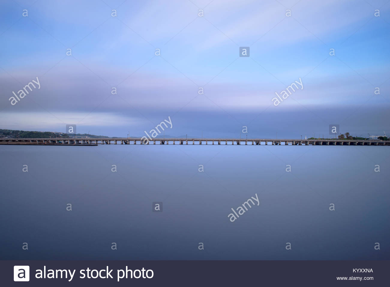 Scenic view of bridge over sea against cloudy sky - Stock Image