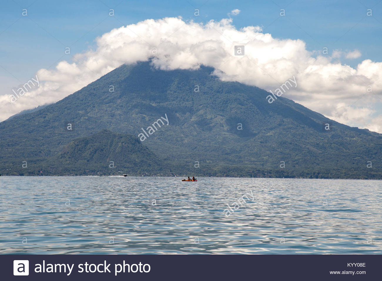 Scenic view of Lake Atitlan against mountains and cloudy sky - Stock Image