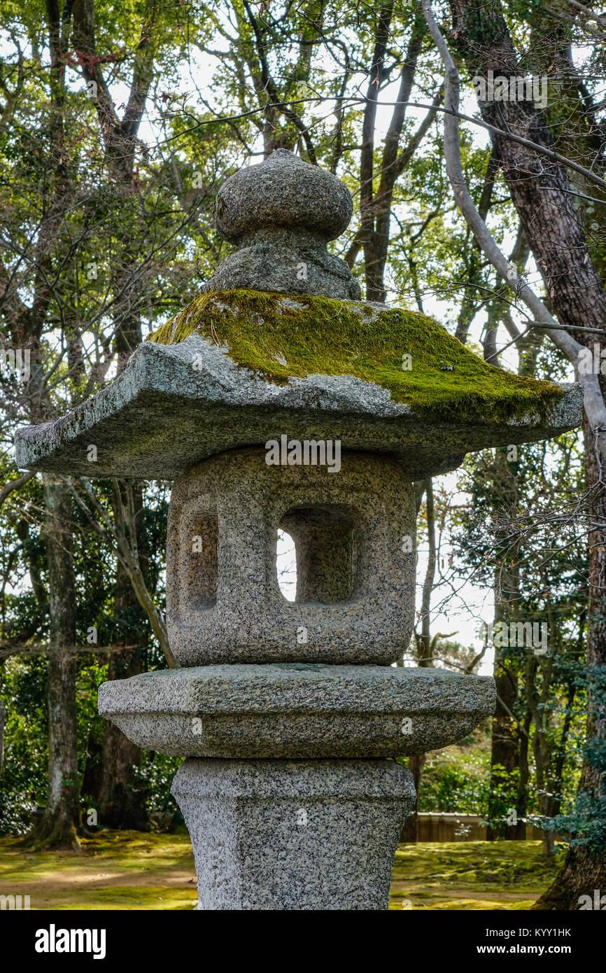 Stone lantern of zen garden at ancient Shinto Shrine in Kyoto, Japan. - Stock Image