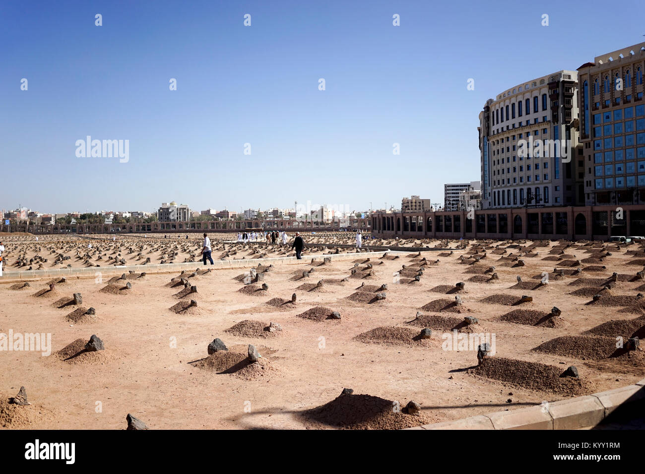 People at Jannat al-Baqi against clear sky in city - Stock Image