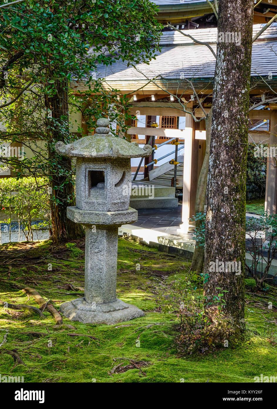 Kyoto, Japan - Dec 26, 2015. A traditional lantern at zen garden of Ryoanji Temple in Kyoto, Japan. Ryoanji Temple - Stock Image