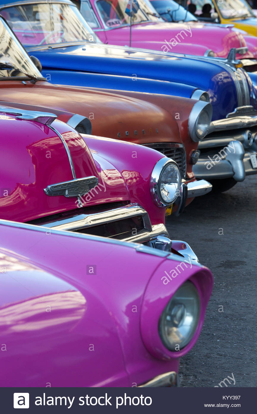Colorful vintage cars parked on street in city - Stock Image